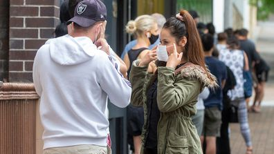 People are seen lining up at a COVID-19 testing centre at the East Sydney Community and Arts Centre in Darlinghurst, Sydney. Sydney's northern beaches is on lockdown, as a cluster of COVID-19 cases continues to grow causing other Australian states and territories to impose restrictions on travel ahead of the Christmas holidays.