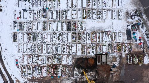 An aerial view of recent burial chambers at Sutton New Hall Cemetery in Sutton Coldfield, England. UK government figures indicate that people who have died with coronavirus in the UK has exceeded 100,000