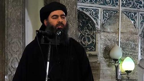 A still from a video released on July 5 by Al-Furqan Media shows alleged ISIL leader Abu Bakr al-Baghdadi preaching at an event. (Getty)
