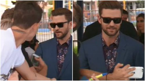Timberlake treated fans to plenty of autographs and 'selfies'. (9NEWS)