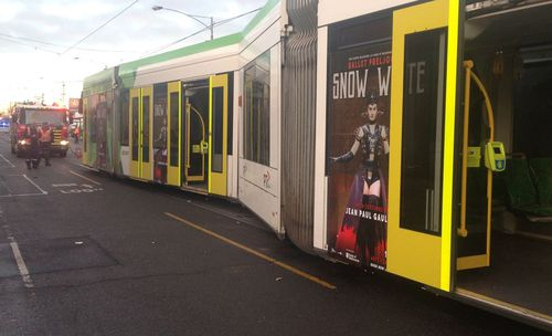 The tram was knocked off the tracks in the crash. Picture: Madeline Slattery