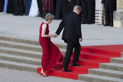 Trump also took her hand as the ascended the stairs at Blenheim Palace, Oxfordshire, where May was hosting a dinner.