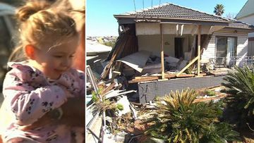 A toddler was buried in rubble when a car ploughed into a house.