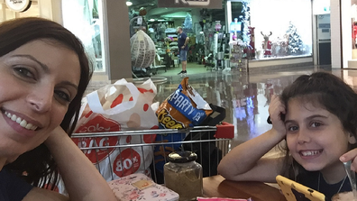 Jo Abi and her daughter grocery shopping