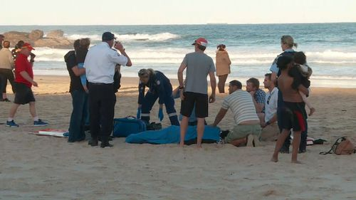 Rescuers on the beach. (9NEWS)