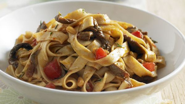 Tagliatelle with porcini, pine nuts, fresh tomato and thyme