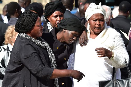 Akon Guode at the funeral service for her three children before being charged with their murder.