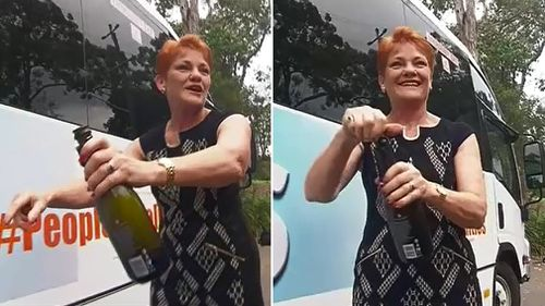 Pauline Hanson christens the 'Battler Bus' with champagne. (9NEWS)