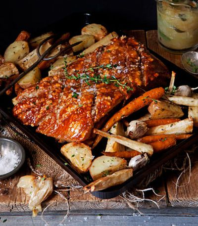 Pork belly with slow-roasted winter vegetables and apple and sage sauce
