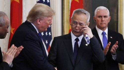 "President Donald Trump shakes hands with Chinese Vice Premier Liu He before signing ""phase one"" of a US China trade agreement."