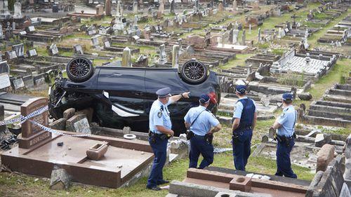 Police survey the crash scene today. (AAP)