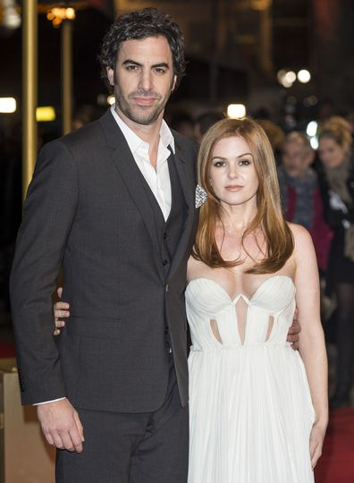 """Isla Fisher and Sacha Baron Cohen attend the world premiere of """"Les Miserables"""" at Odeon Leicester Square on December 5, 2012 in London, England."""