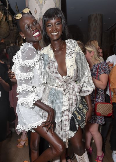 Ajak Deng and former Australia's Next Top Model contestant Duckie Thot at the Australian Fashion Foundation 2017 summer party at The Whitby Hotel, New York.
