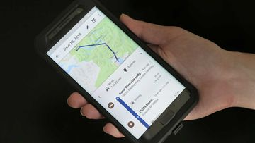 A mobile phone displays a user's travels using Google Maps