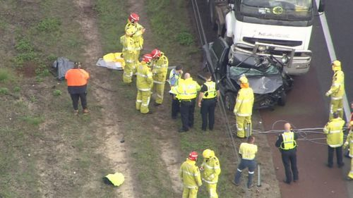 A Hyandai hatchback was completely crushed by the truck, to the point that it was almost split in half. Picture: 9NEWS