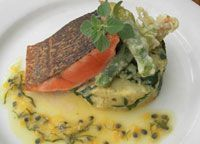 Grilled Atlantic salmon on crushed kipfler potatoes, tempura zucchini flower, wilted spinach