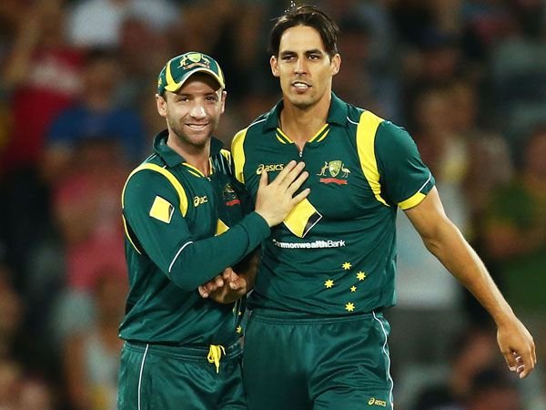 Phil Hughes and Mitchell Johnson. (Getty)