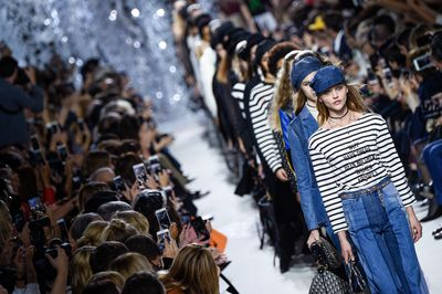<p>Just 12 months after she sent models down the runway wearing T-shirts emblazoned with the message We Should All Be Feminists,&nbsp;Maria Grazia Chiuri, the first female designer to head the house of Dior, has done her bit for women all over again.</p> <p>This time the message - Why Have There Been No Great Women Artists? A perfectly reasonable question to ponder. The truth, of course, is that there has been and is plenty of them, only they did not and do not garner the attention afforded to their male counterparts.</p> <p>If anyone is working to change that, it's Chiuri, who is clearly a great artist herself. Her show was eclectic, colourful and filled with extraordinary detail. There was embroidered fiery dragons, bejeweled heels, glitz and glitter and all things magical.</p> <p>Silhouettes were flattering and wearable too making this a memorable collection with flair and also, more importantly, wear-ability. Scroll through our pic gallery for the best looks from the day.</p>