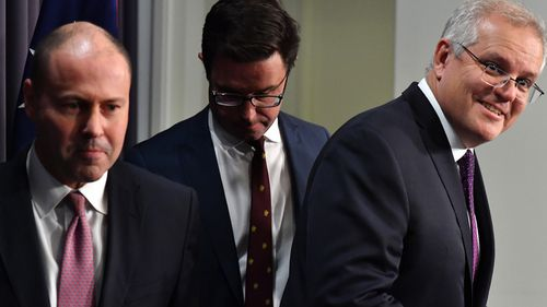 Treasurer Josh Frydenberg, Minister for Agriculture David Littleproud and Prime Minister Scott Morrison during a press conference announcing the new financial package for Australians hit by snap lockdowns.