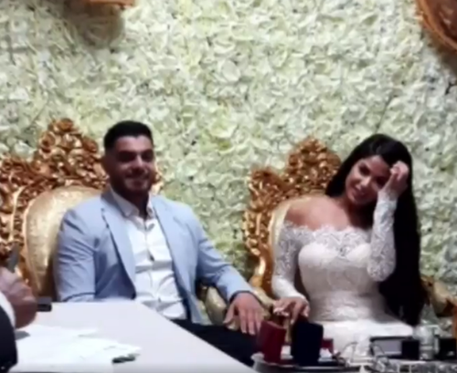 Mr Sayour can also be seen grinning during the ceremony. (9NEWS)