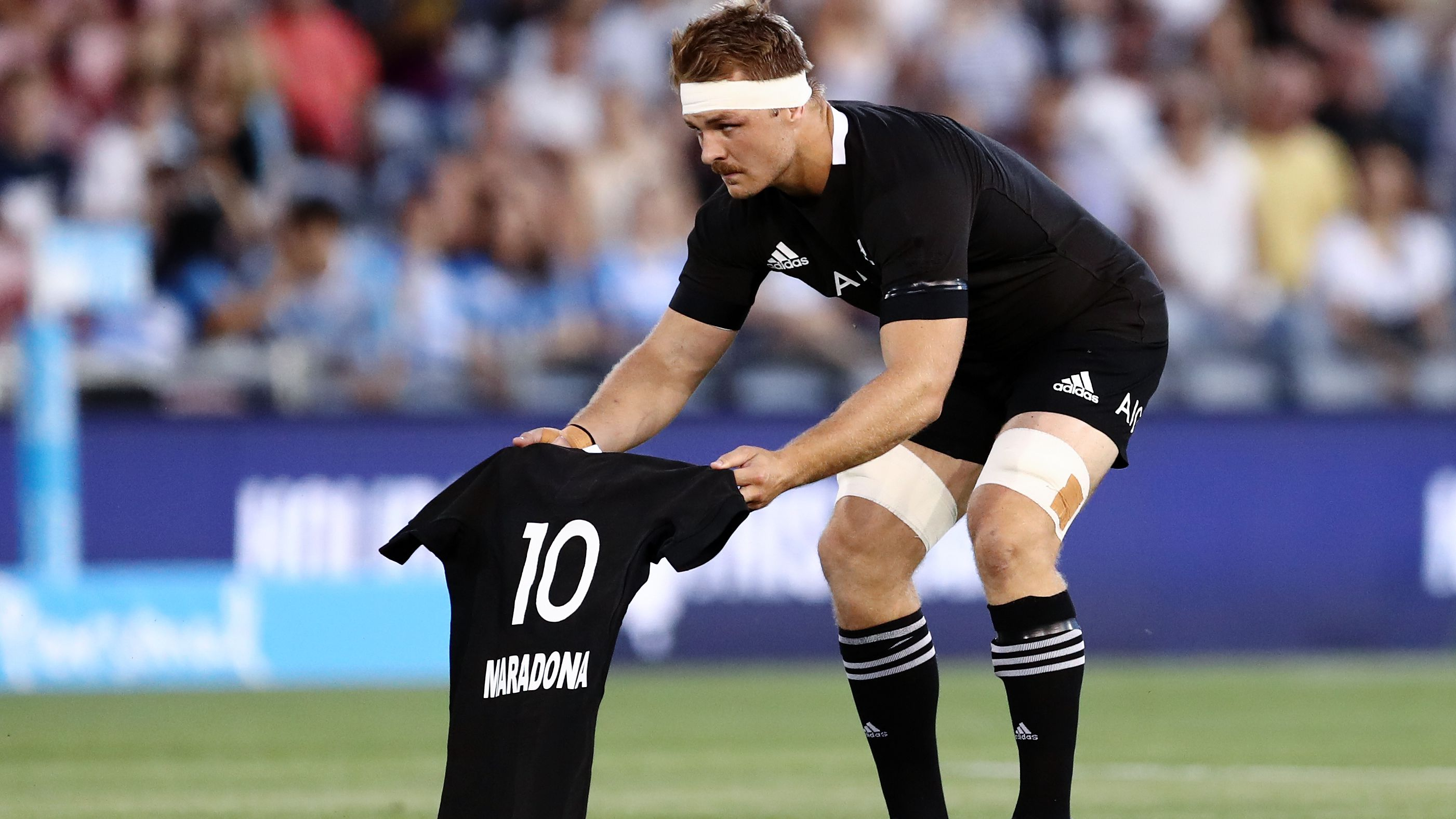Sam Cane of the All Blacks lays down a number 10 jersey in memory of Diego Maradona.