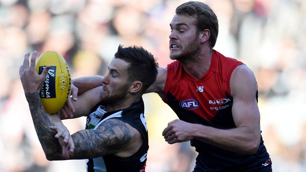 Demon Jack Watts spoils Magpies' Jeremy Howe's catch (AAP)