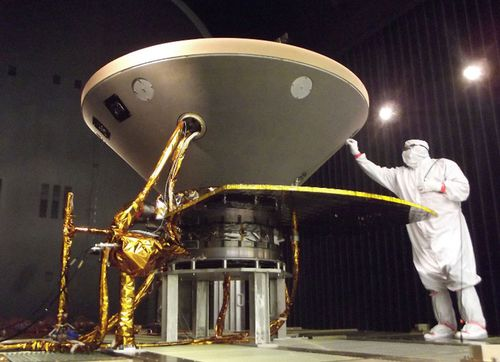 This file photo shows a NASA technician preparing the InSight spacecraft for thermal vacuum testing.