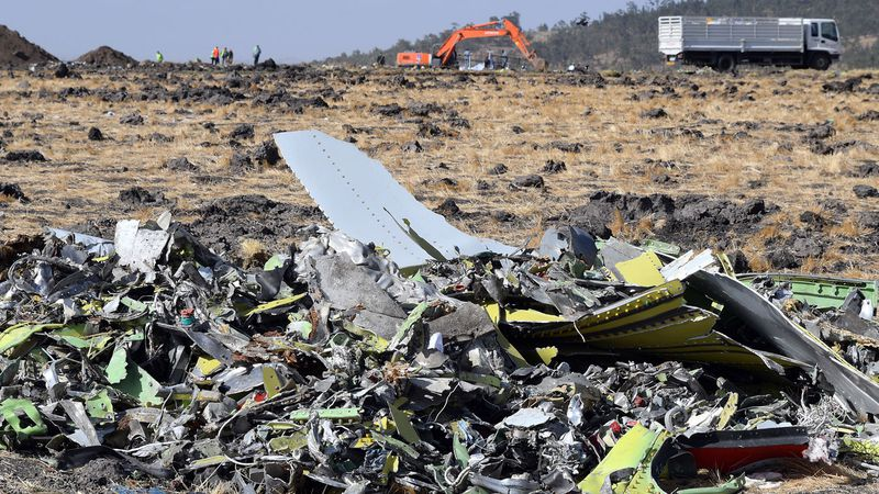 Pieces of the wreckage of an Ethiopia Airlines Boeing 737 Max 8 aircraft are piled at the crash site near Bishoftu, Ethiopia.
