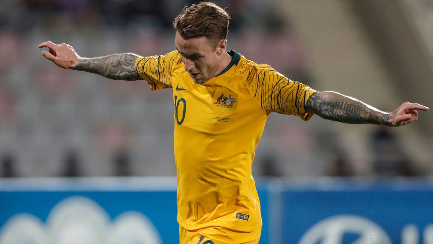 Adam Taggart celebrates scoring for the Socceroos