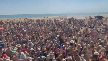 Revellers packed onto a sandbar in Darwin.