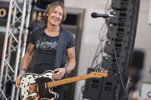 Australian country music star Keith Urban was helped out at the till of a store when he was short of a few dollars. Picture: AAP.
