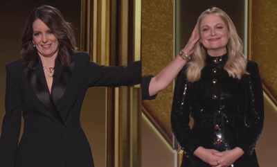 Tina Fey strokes Amy Poehler's head during opening monologue