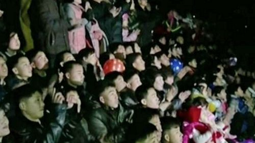 A rapt crowd watches New Year's Eve fireworks in North Korea.