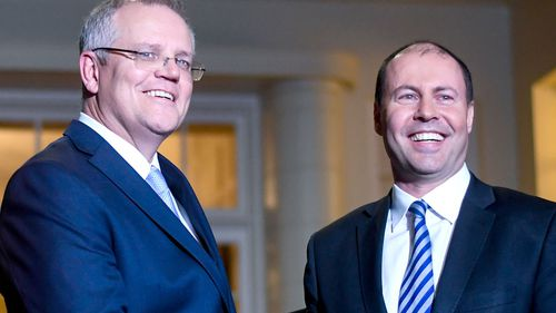 Prime Minister Scott Morrison and Deputy Liberal leader Josh Frydenberg after the swearing in ceremony at Government House in Canberra.