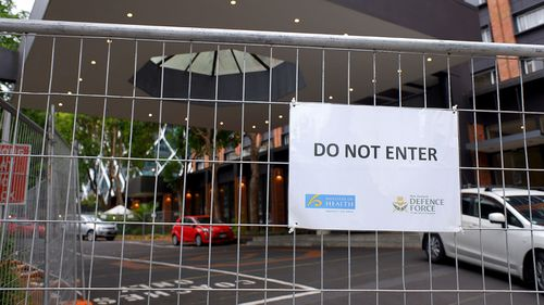 Auckland residents are being urged to remain vigilant for coronavirus symptoms after another two people who completed 14 days of hotel quarantine at the Pullman Hotel tested positive for COVID-19.