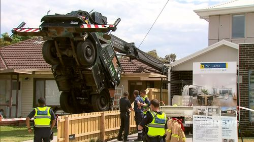 The crane is yet to be removed from the Altona home.