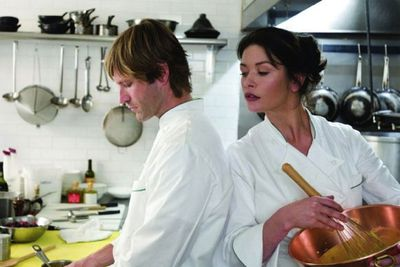 Catherine Zeta-Jones and Aaron Eckhart get feisty and flirty in the kitchen in this rom-com. And Catherine is the most smokin' head chef we've ever seen!<br/><br/>(Image: Warner Bros)