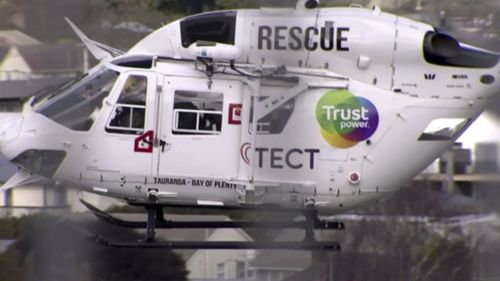 A helicopter is dispatched to the crash scene in Waikato, New Zealand. (TVNZ via AP)
