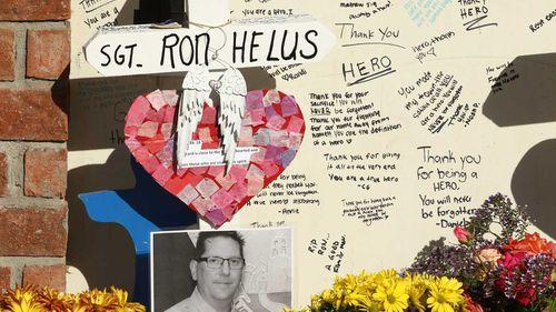 Memorials left for Sgt Ron Helus.