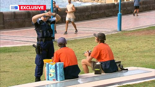 Tradies eating their lunch at Coogee are told to move on.