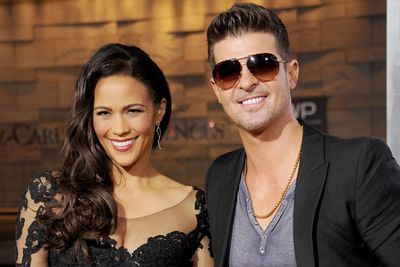 """These former lovebirds split in February 2014 after eight years of marriage, with many pointing at their seemingly 'open' relationship as a possible trigger.<br/><br/>'Blurred Lines' singer Robin was caught with his hand up the skirt of a socialite at a VMAs after-party... and the girl in question, Lana Scolaro, later claimed they had a tryst while his wife was at the party!<br/><br/>When asked if he and his wife has threesomes, Robin told <i>The Howard Stern Show</i>: """"Out of respect for her, we just won't answer that one."""""""