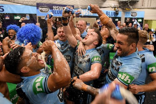 Celebrating Blues players are awash with beer in the sheds. Picture: AAP