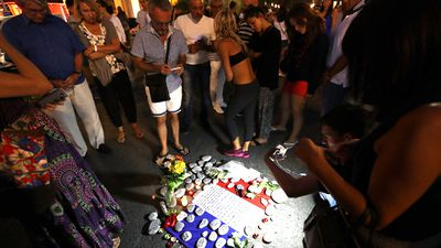 Crowds have gathered at a make-shift memorial for victims of the deadly Bastille Day attack on the Promenade des Anglais in Nice. Source: AFP