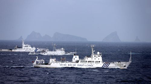 ISHIGAKI, JAPAN - APRIL 23:     In this aerial image, a China Marine Surveillance vessels (front and middle) cruises with a Japan Coast Guard ship near Kita kojima and Minami kojima of the disputed Senkaku Islands on April 23, 2013 in Ishigaki, Okinawa, Japan. 8 Chinese ships intruded into Japan's territorial water for up to 12 hours.  (Photo by The Asahi Shimbun via Getty Images)