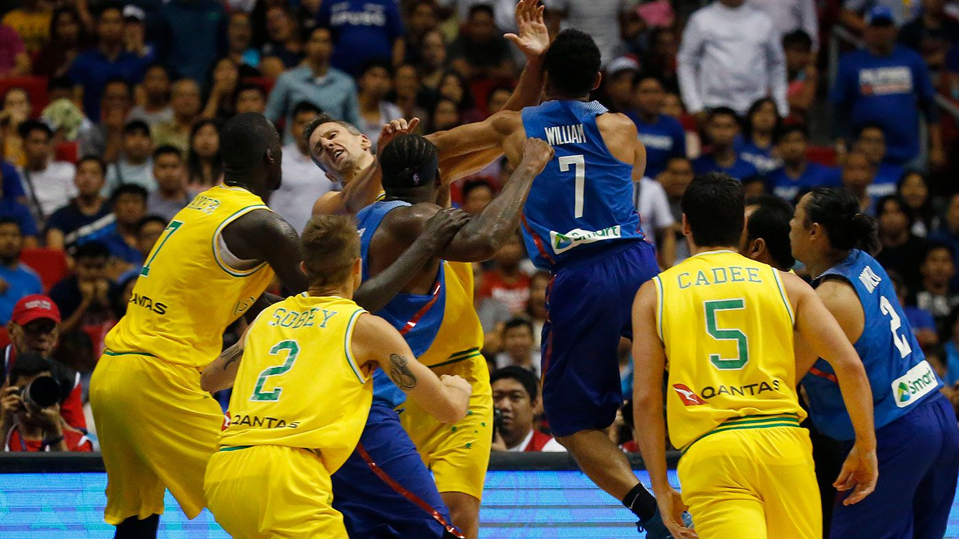 The Philippines' Jason William, (centre), jumps to hit Australia's Daniel Kickert (centre left) as others rush to break the brawl during the FIBA World Cup Qualifier between Australia and Philippines.