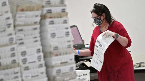 Arizona elections officials continue to count ballots inside the Maricopa County Recorder's Office.