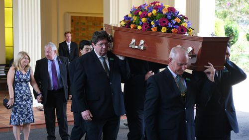 Faye and Mark Leveson watch as their son Matthew's coffin is carried out. (AAP)