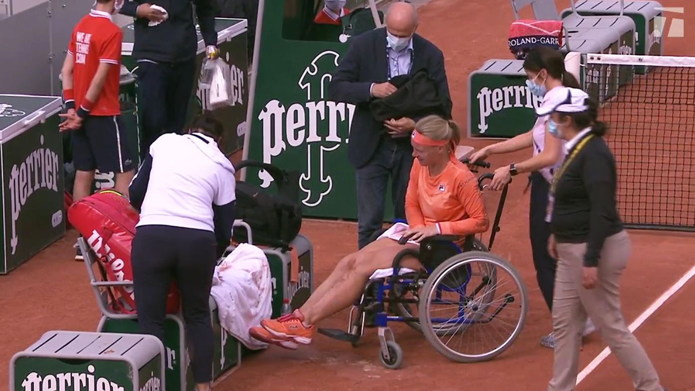 Bertens receives treatment on a wheelchair at the French Open