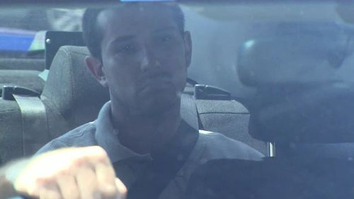 Mark Dayney in a police vehicle ahead of his first court appearance.
