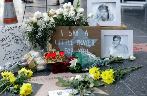 Flowers and signs are placed on Aretha Franklin's star at the Hollywood Walk of Fame.
